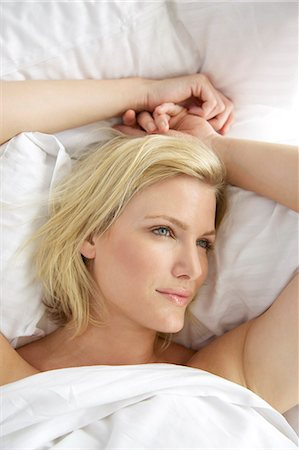 Portrait of a blonde woman waking up in bed Stock Photo - Rights-Managed, Code: 847-05607039