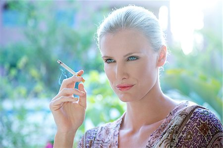 Landscape image of a woman smoking a cigarette Stock Photo - Rights-Managed, Code: 847-05607033