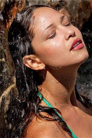 Beautiful girl in pool with water splashing on her face Stock Photo - Rights-Managed, Code: 847-05809820