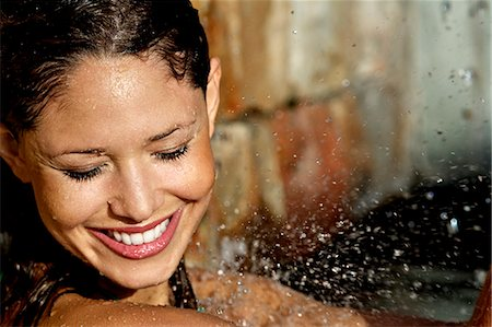 Beautiful girl in pool with splashing water Stock Photo - Rights-Managed, Code: 847-05809834