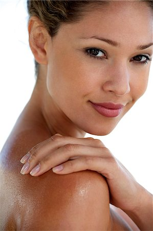 Beautiful girl rubbing massage oil into her skin Stock Photo - Rights-Managed, Code: 847-05809887