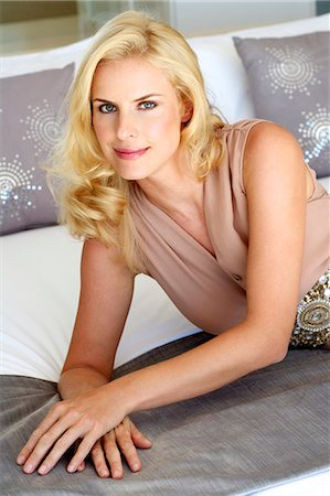 Beautiful blonde woman relaxing on a bed Stock Photo - Rights-Managed, Code: 847-05818369