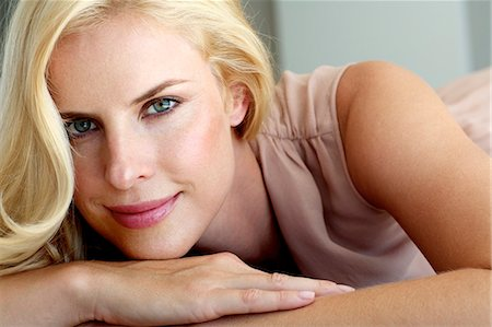 Beautiful blonde woman relaxing on a bedl Stock Photo - Rights-Managed, Code: 847-05818377