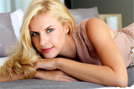 Beautiful blonde woman relaxing on a bed Stock Photo - Rights-Managed, Code: 847-05818371
