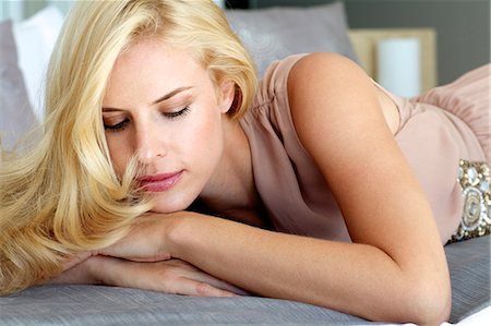 Beautiful blonde woman relaxing on a bed Stock Photo - Rights-Managed, Code: 847-05818372