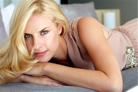 Beautiful blonde woman relaxing on a bed Stock Photo - Rights-Managed, Code: 847-05818373