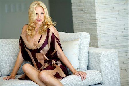 Beautiful blonde woman relaxing on a sofa Stock Photo - Rights-Managed, Code: 847-05818381