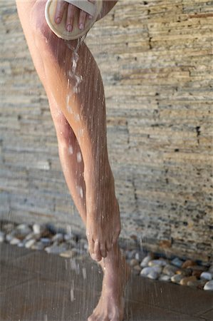 Close-up of beautiful feet and legs in an outdoor shower Stock Photo - Rights-Managed, Code: 847-05818415