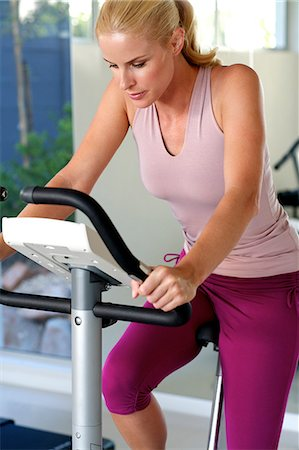 Beautiful blonde woman cycling at the gym Stock Photo - Rights-Managed, Code: 847-05818420