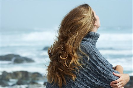 Beautiful young woman sitting by ocean Stock Photo - Rights-Managed, Code: 847-06540551