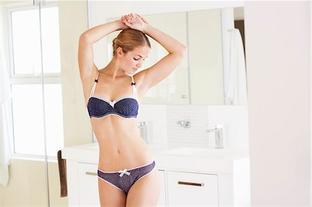 Beautiful young woman standing in underwear Stock Photo - Rights-Managed, Code: 847-06540619