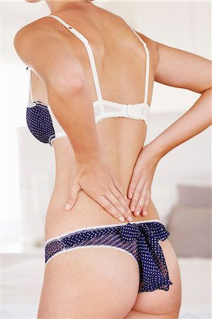 Beautiful young womans back, wearing underwear Stock Photo - Rights-Managed, Code: 847-06540624