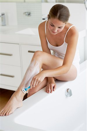 Beautiful young woman shaving legs Stock Photo - Rights-Managed, Code: 847-06540631