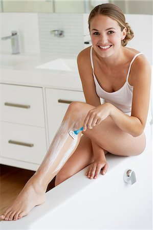 Beautiful young woman shaving legs Stock Photo - Rights-Managed, Code: 847-06540632