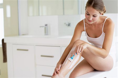 Beautiful young woman shaving legs Stock Photo - Rights-Managed, Code: 847-06540633
