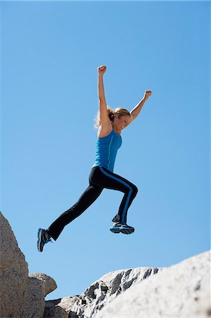 Healthy mature woman jumping over rocks Stock Photo - Rights-Managed, Code: 847-06540657