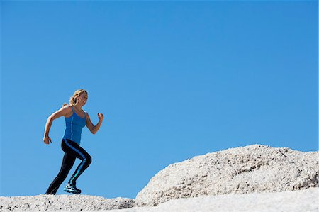 Healthy mature woman jumping over rocks Stock Photo - Rights-Managed, Code: 847-06540658