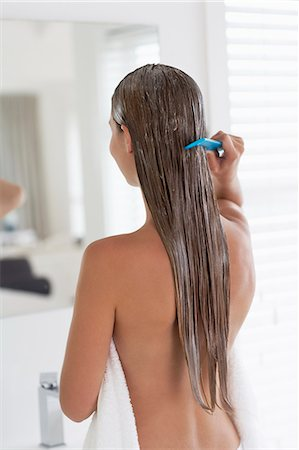 Beautiful woman combing clean conditioned hair Stock Photo - Rights-Managed, Code: 847-06540651