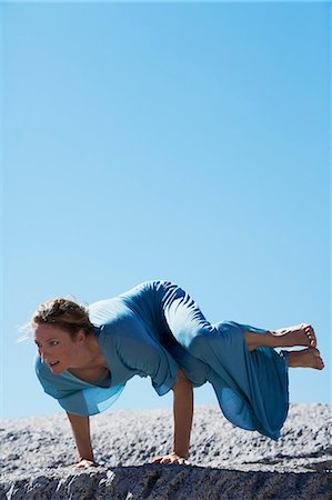Healthy mature woman doing yoga on rocks Stock Photo - Rights-Managed, Code: 847-06540666