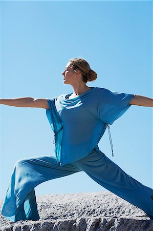 Healthy mature woman doing yoga on rocks Stock Photo - Rights-Managed, Code: 847-06540669