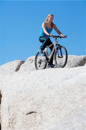 Healthy mature woman riding bike on rocks Stock Photo - Rights-Managed, Code: 847-06540661