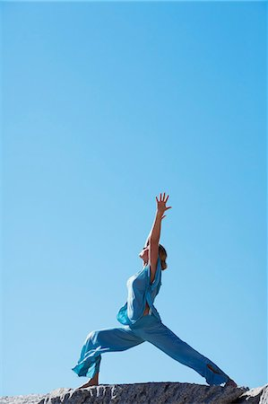 Healthy mature woman doing yoga on rocks Stock Photo - Rights-Managed, Code: 847-06540672