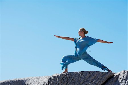 Healthy mature woman doing yoga on rocks Stock Photo - Rights-Managed, Code: 847-06540673