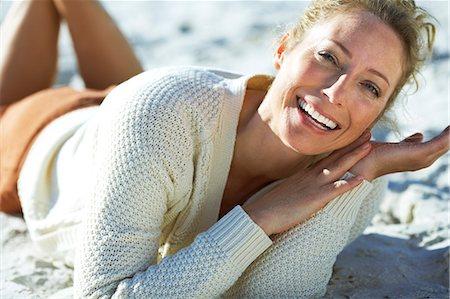 Beautiful mature woman sitting on beach Stock Photo - Rights-Managed, Code: 847-06540699