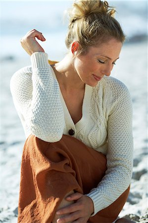 Beautiful mature woman sitting on beach Stock Photo - Rights-Managed, Code: 847-06540702