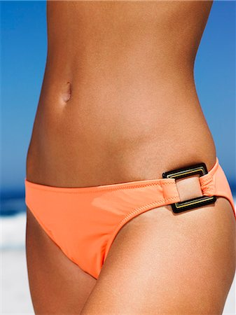 Body shot of girl on the beach in an orange swimsuit Stock Photo - Rights-Managed, Code: 847-08522666