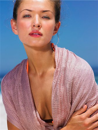 Beautiful brunette wearing a pink sarong Stock Photo - Rights-Managed, Code: 847-08522669