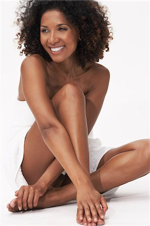 Beautiful afro-caribbean woman in a white towel Stock Photo - Rights-Managed, Code: 847-08522746