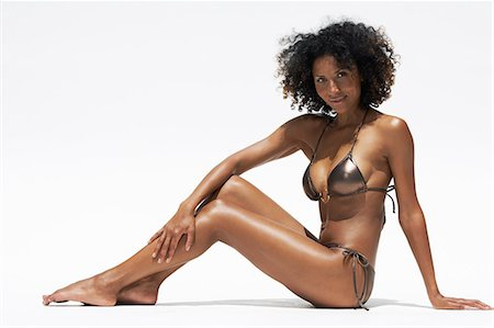 Body shot of afro-caribbean woman in a bikini Stock Photo - Rights-Managed, Code: 847-08522749