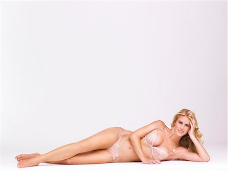 Full-length body shot of beautiful blonde woman lying down Stock Photo - Rights-Managed, Code: 847-08522776