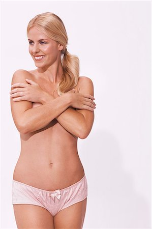 Topless body shot of beautiful, happy blonde Stock Photo - Rights-Managed, Code: 847-08522784