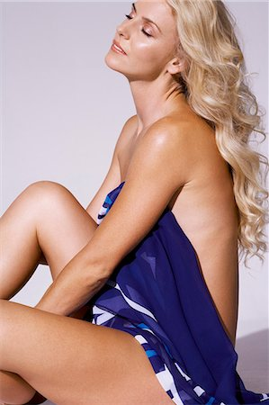 Naked body shot of beautiful blonde covering herself with a scarf Stock Photo - Rights-Managed, Code: 847-08522785