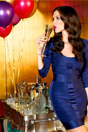 shiny - Beautiful brunette celebrating with champagne at a party Stock Photo - Rights-Managed, Code: 847-08522789