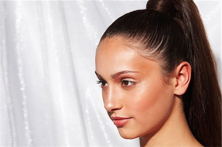 Close-up of glamorous young woman with glowing skin and a high ponytail Stock Photo - Rights-Managed, Code: 847-08522927