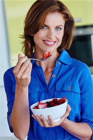 Healthy woman enjoying a bowl of fruit. Stock Photo - Rights-Managed, Code: 847-08655603