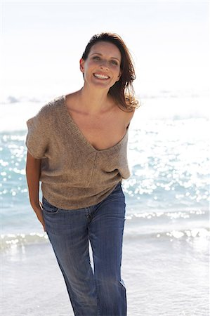 Beautiful mature lady walking on the beach Stock Photo - Rights-Managed, Code: 847-02786360