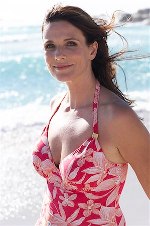 seniors woman in swimsuit - Beautiful mature lady walking on the beach Stock Photo - Rights-Managed, Code: 847-02786396