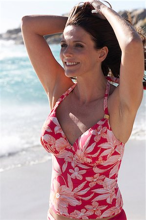 seniors woman in swimsuit - Beautiful mature lady walking on the beach Stock Photo - Rights-Managed, Code: 847-02786397