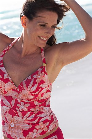 seniors woman in swimsuit - Beautiful mature lady walking on the beach Stock Photo - Rights-Managed, Code: 847-02786403