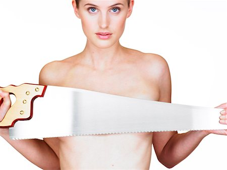 Landscape of girl with saw held across breasts Stock Photo - Rights-Managed, Code: 847-02781140