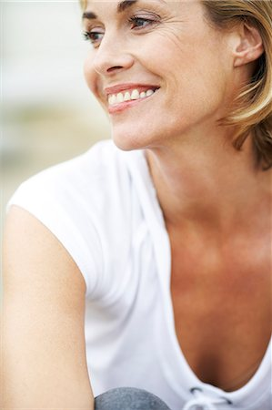 Portrait of happy, mature woman outside at beach house Stock Photo - Rights-Managed, Code: 847-02781531