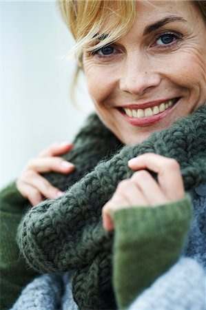 Portrait of happy, mature woman in cosy roll neck jumper Stock Photo - Rights-Managed, Code: 847-02781627