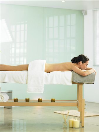 Cropped full length of woman on spa massage bed Stock Photo - Rights-Managed, Code: 847-02782314