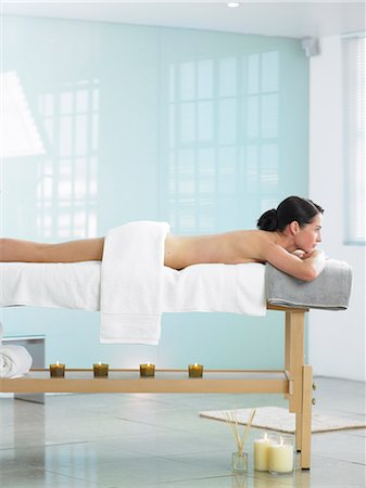 Cropped full length of woman on spa massage bed Stock Photo - Rights-Managed, Code: 847-02782315