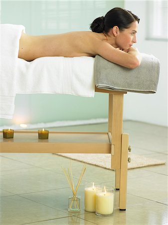 Woman lying on massage table in spa location Stock Photo - Rights-Managed, Code: 847-02782316
