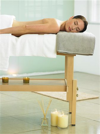 Woman lying on massage table in spa location Stock Photo - Rights-Managed, Code: 847-02782318